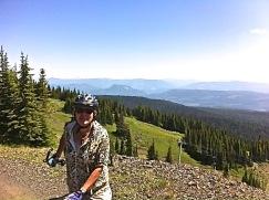 Sharolie biking on ski run